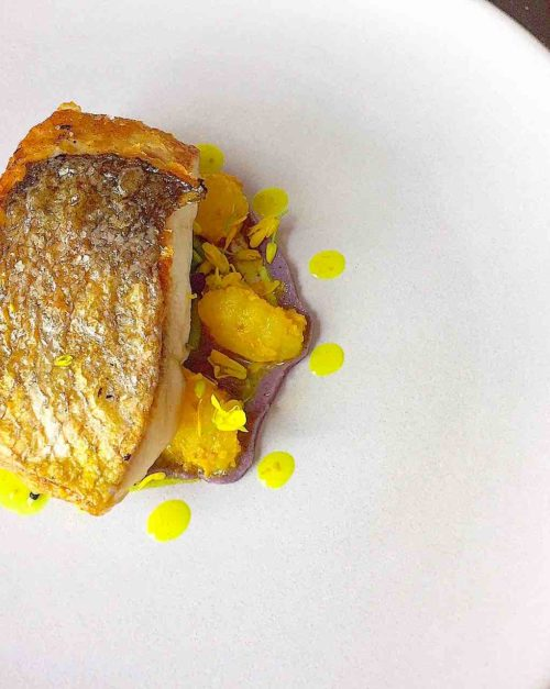 Sea Bass with apples and cabbage